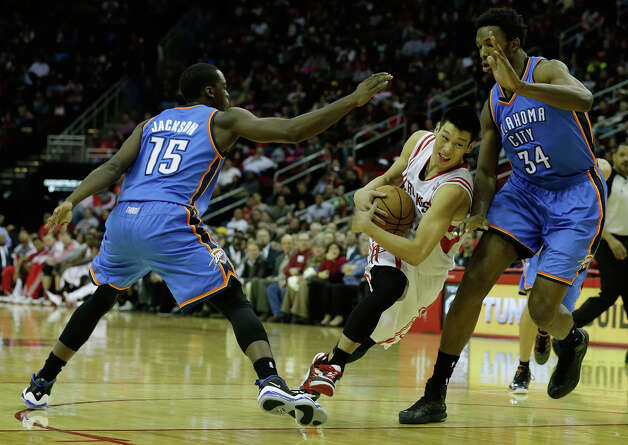 Jeremy Lin dribbles against Reggie Jackson #15 and Hasheem Thabeet. Photo: Scott Halleran, Getty Images / 2012 Getty Images