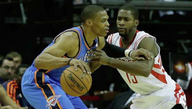 Russell Westbrook is defended by Toney Douglas. Photo: Scott Halleran, Getty Images / 2012 Getty Images