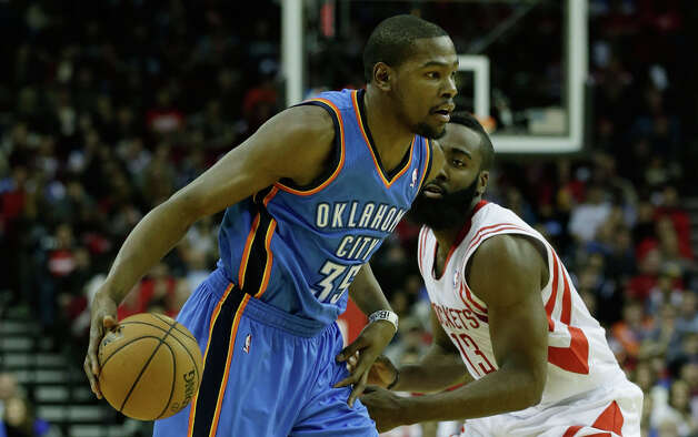 Kevin Durant #35 of the Thunder drives past James Harden #13 of the Rockets. Photo: Scott Halleran, Getty Images / 2012 Getty Images