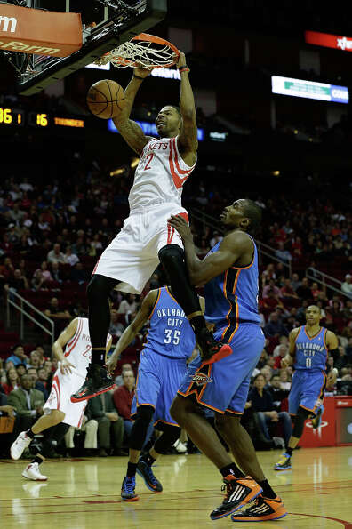 Marcus Morris #2 of the Rockets dunks over Serge Ibaka.
