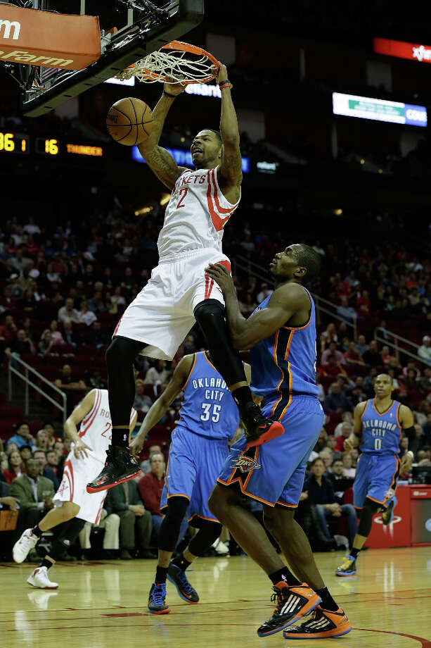 Marcus Morris #2 of the Rockets dunks over Serge Ibaka. Photo: Scott Halleran, Getty Images / 2012 Getty Images