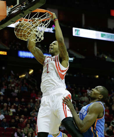 Marcus Morris #2 of the Rockets dunks over Serge Ibaka #9 of the Thunder. Photo: Scott Halleran, Getty Images / 2012 Getty Images