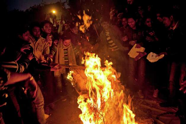 Indians burn effigy of the rapists during a candle-lit vigil to mourn the death of a gang rape victim in New Delhi, India, on Sunday. The woman who died after being gang-raped and beaten on a bus in India's capital was cremated Sunday amid an outpouring of anger and grief by millions across the country demanding greater protection for women from sexual violence. Photo: AP