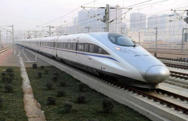 In this photo released by China's Xinhua news agency, a high-speed train G802 leaves for Beijing from Shijiazhuang, capital of north China's Hebei Province, Wednesday. China has opened the world's longest high-speed rail line, which runs 1,428 miles from the country's capital in the north to Guangzhou, an economic hub in the Pearl River delta in southern China.  Photo: AP