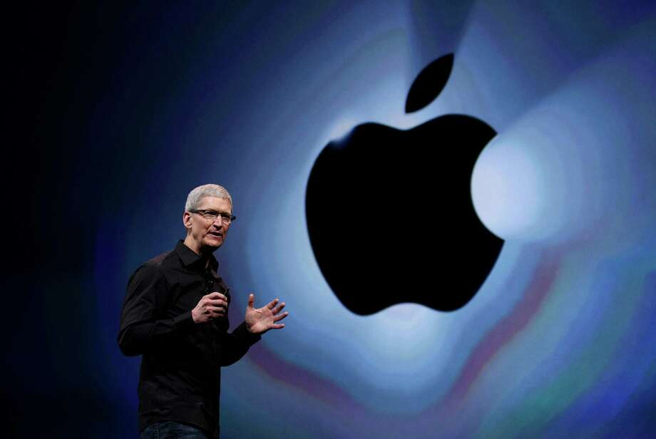 Apple CEO Tim Cook speaks during an introduction of the new iPhone 5 in San Francisco earlier this year. Cook got a relatively modest $4.2 million in pay for 2012, after the company's board set him up with stock now worth $510 million for taking the reins in 2011. Photo: AP