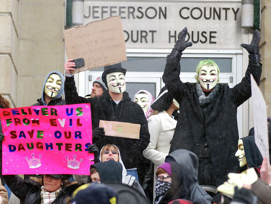 Activists from the online group Anonymous protest at the Jefferson County Courthouse in Steubenville, Ohio, on Saturday. Members of the group said they are outraged over what they contend is a cover-up in a case involving the alleged rape of a teenage girl by Steubenville High School student-athletes that reportedly occurred in 2012. Police estimated the crowd at 300. Photo: AP