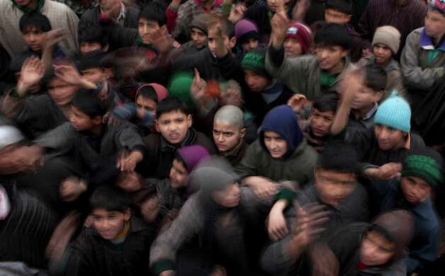 Kashmiri boys shout freedom slogans during the funeral procession of Imtiyaz Ahmed, a suspected militant of Lashkar-e-Taiba, in Petipora, a village 34 miles south of Srinagar, India on Friday. Indian forces on Friday killed two suspected rebels in a gunbattle and wounded seven civilians later during anti-India protests in southern Kashmir, police said. Photo: AP