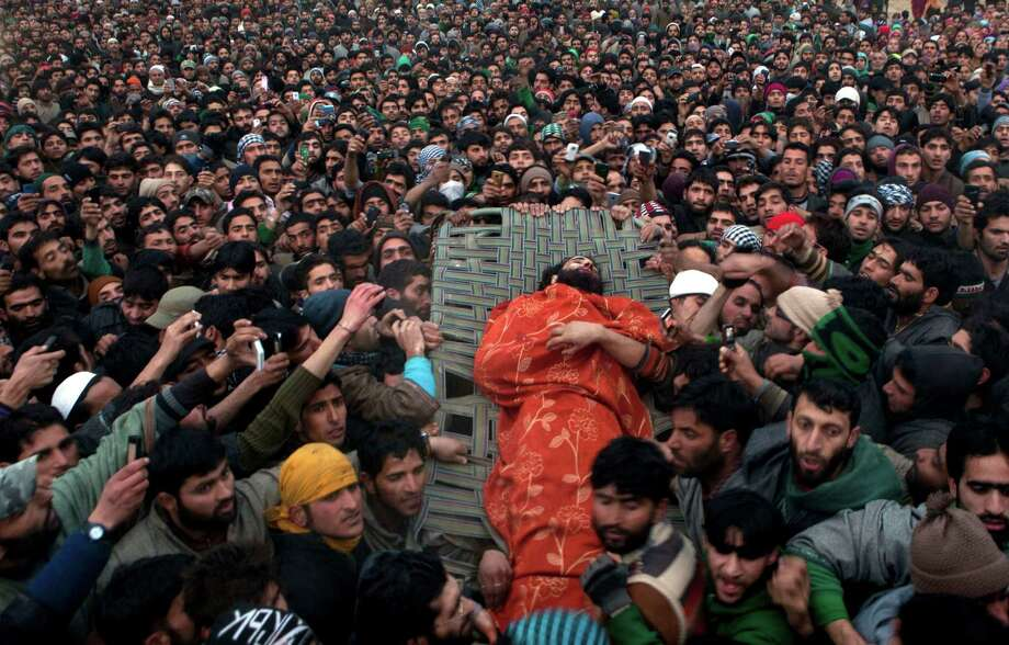 Kashmiri Villagers carry the body of Imtiyaz Ahmed, a suspected militant of Lashkar-e-Taiba, during his funeral procession in Petipora, a village 34 miles south of Srinagar, India, on Friday. Indian forces on Friday killed two suspected rebels in a gunbattle and wounded seven civilians later during anti-India protests in southern Kashmir, police said. Photo: AP