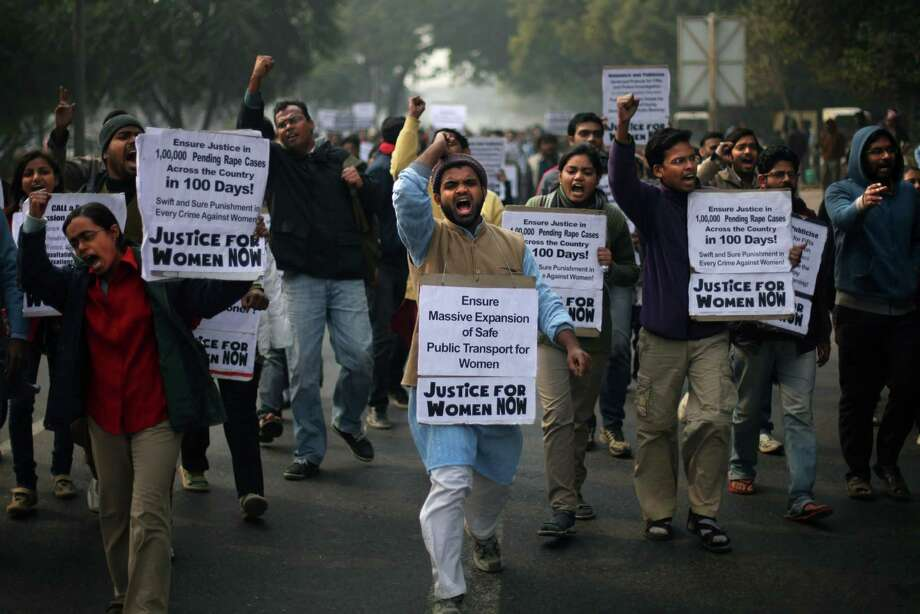 Indian protesters shout slogans as they demonstrate against the recent gang-rape of a young woman in a moving bus in New Delhi, India, Thursday. Indian Prime Minister Manmohan Singh pledged Thursday to take action to protect the nation's women while the young rape victim was flown to Singapore for treatment of severe internal injuries. Photo: AP