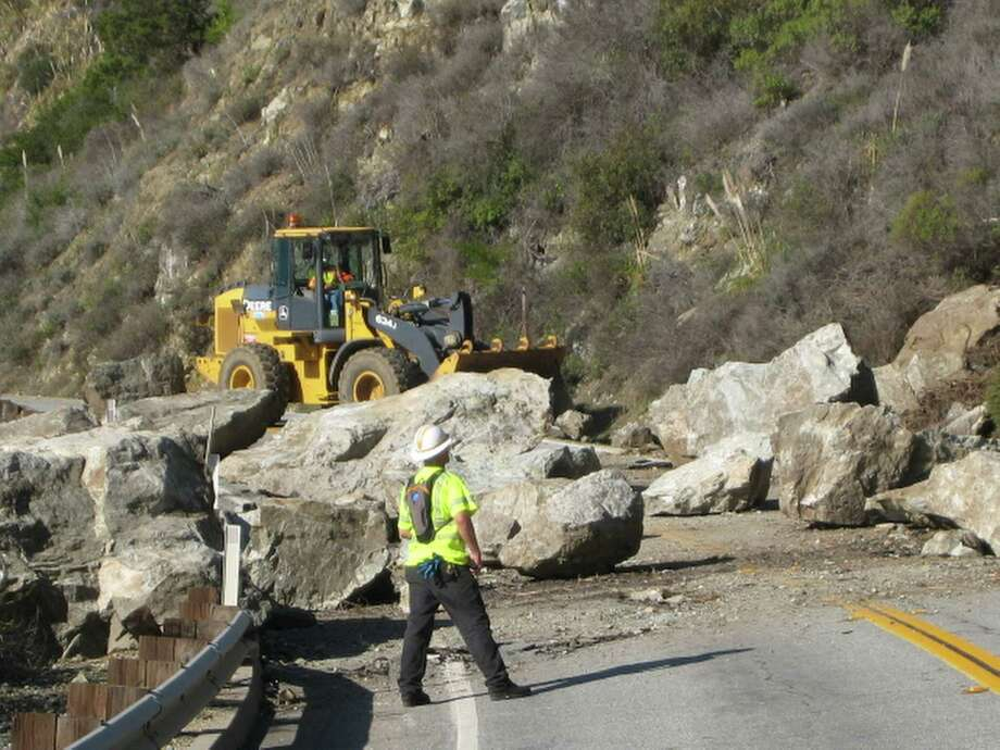 In this photo provided by Caltrans, crews work to clear debris from a rock slide that forced the closure of Highway 1 through the Big Sur area of the California coast on Wednesday.  State transportation officials say after closing the highway Monday at Partington Ridge Road near the community of Big Sur, crews will open one lane of the highway to let traffic through at 8 a.m., noon and 4 p.m. on Thursday. Caltrans spokesman Colin Jones says because the section of roadway is near an active slide area, the flow of traffic will be controlled when the highway is open. Photo: AP