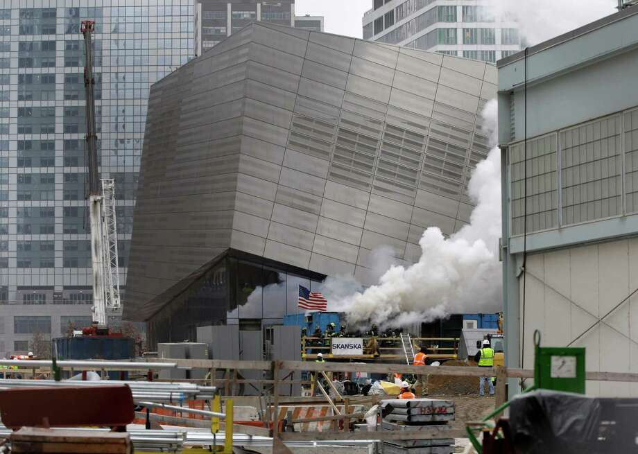 Smoke billows from storage containers located beside the National September 11 Memorial & Museum as firefighters respond to a fire at the World Trade Center site in New York on Wednesday.  There were no reports of injuries. Photo: AP