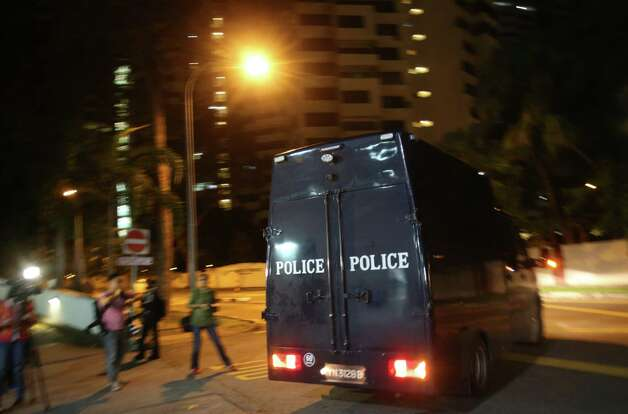 A police hearse leaves Mount Elizabeth Hospital on Saturday in Singapore. A young Indian woman who was gang-raped and severely beaten on a bus in New Delhi died Saturday at the hospital, after her horrific ordeal galvanized Indians to demand greater protection from sexual violence that impacts thousands of women daily, in homes, streets and public transport, but which often goes unreported. Photo: AP