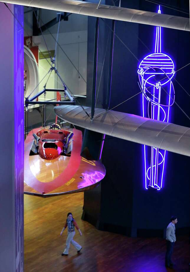 "Shown on Wednesday, a neon replica of original Space Needle sketches, right, is on display alongside the Slo-Mo-Shun IV hydroplane at Seattle's Museum of History and Industry, in the city's South Lake Union neighborhood.""MOHAI"" officially opened at its new location on Saturday. Photo: AP"