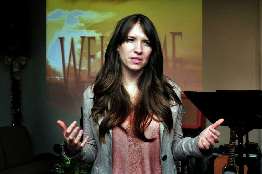 "Crystal Miller, a survivor of the 1999 Columbine High School shooting in Colo., speaks of ""Hope out of Tragedy"" at Calvary Chapel in Southbury, Conn., Sunday, Dec. 30, 2012. Photo: Michael Duffy / The News-Times"