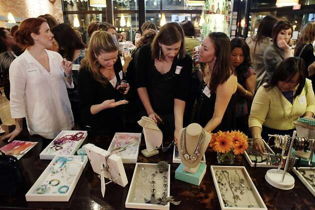 Party guests peruse new designs for Stella & Dot at a release party at Billy Berk's in San Jose, Calif., on Sunday, January 23, 2011. Stanford graduate Jessica Herrin co-founded WeddingChannel.com at age 24. Now she's started Stella & Dot, in which its army of independent sellers throw parties and sell jewelry in the style of Pampered Chef and Avon.  It sees itself changing past notions of direct sales, tapping the web and social media to help its stylists, many of them moms like herself. Photo: Carlos Avila Gonzalez, The Chronicle