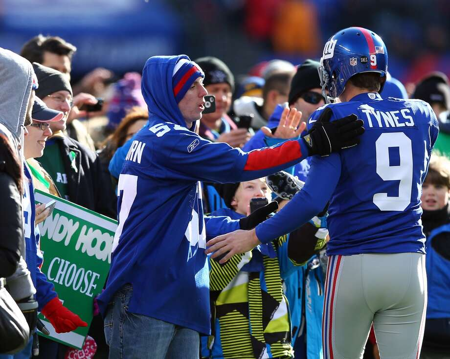 EAST RUTHERFORD, NJ - DECEMBER 30: Lawrence Tynes #9 of the New York Giants greets families from Sandy Hook Elementary School in Newtown, Connecticut before the game between the New York Giants and the Philadelphia Eagles at MetLife Stadium on December 30, 2012 in East Rutherford, New Jersey. (Photo by Elsa/Getty Images)