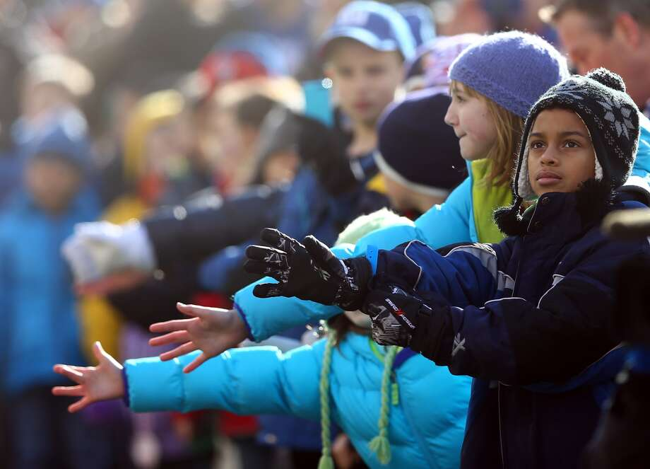 EAST RUTHERFORD, NJ - DECEMBER 30: Families from Sandy Hook Elementary School in Newtown, Connecticut are on the field before the game between the New York Giants and the Philadelphia Eagles at MetLife Stadium on December 30, 2012 in East Rutherford, New Jersey. (Photo by Elsa/Getty Images)