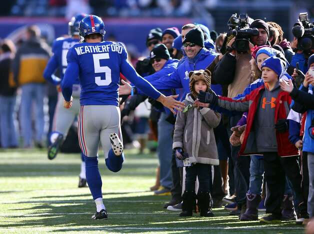 EAST RUTHERFORD, NJ - DECEMBER 30: Steve Weatherford #5 of the New York Giants greets families from Sandy Hook Elementary School in Newtown, Connecticut before the game between the New York Giants and the Philadelphia Eagles at MetLife Stadium on December 30, 2012 in East Rutherford, New Jersey. (Photo by Elsa/Getty Images)
