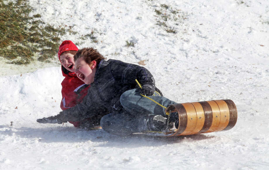 Ryan Kramer, 7, and Chris Imbro, 12, both of Milford, sled at Jonathan Law High School in Milford, Conn. on Sunday, December 30, 2012. Photo: BK Angeletti, B.K. Angeletti / Connecticut Post freelance B.K. Angeletti