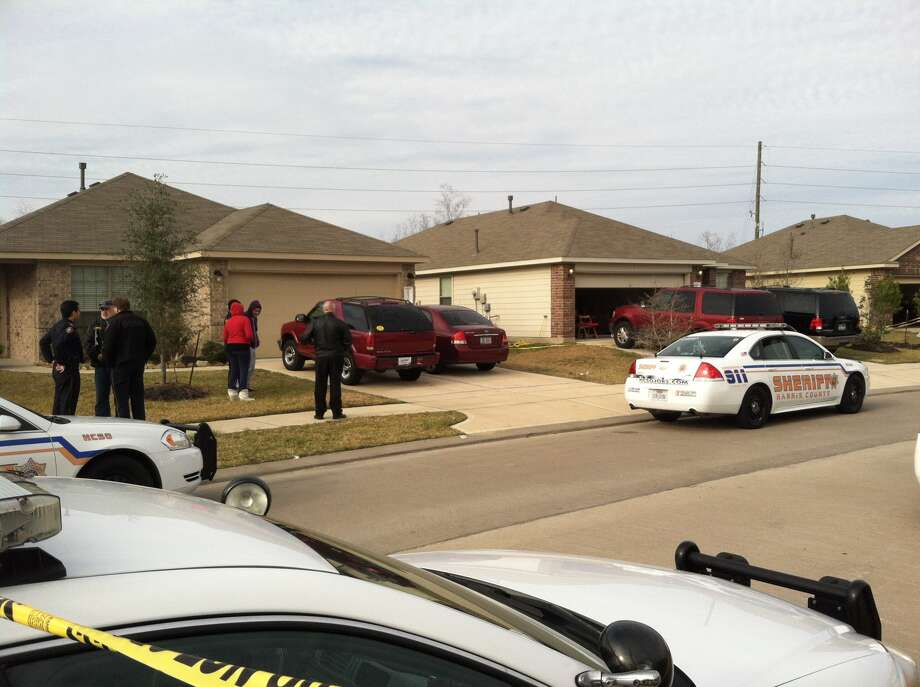 Harris County officers gather at the scene of the shooting.