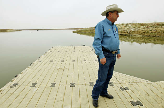 Zapata County Sheriff Sigifredo Gonzalez stands on a dock at Falcon Lake, where David Hartley was shot to death in 2010 while riding Jet Skis with his wife. Gonzalez, who is retiring after 18 years in office, defends his actions after the killing. Photo: Jerry Lara, San Antonio Express-News / © 2012 San Antonio Express-News