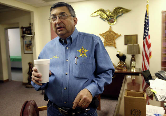 Zapata County Sheriff Sigifredo Gonzalez, Jr. looks around his office Thursday, Dec. 13, 2012. Gonzalez will retire at the end of the year after nearly 19 years in office. One of his accomplishments was helping found the Texas Border Sheriffs Coalition, an advocacy organization that gave rise to the Southwestern Border Sheriffs Coalition. The two organizations bring attention to border security issues, organize for law enforcement officials to testify before state legislatures and Congress and administer grants to border agencies. Photo: Jerry Lara, San Antonio Express-News / © 2012 San Antonio Express-News