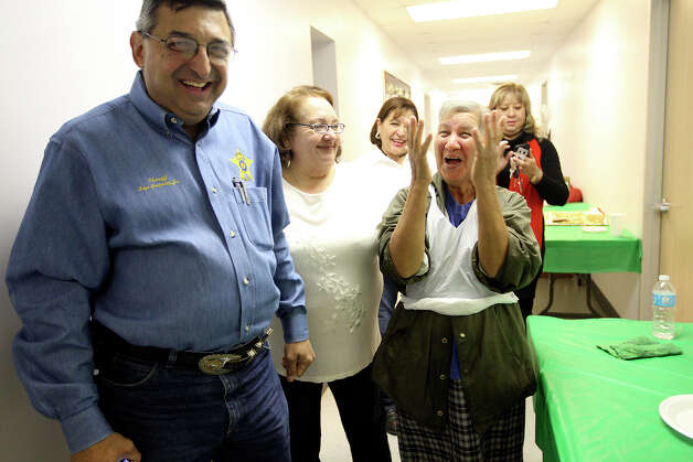 Gonzalez (from left) jokes with Beatriz Longoria, Enedelia Garcia, Enedelia Chapa Garza and San Juanita Tovar at his recent retirement tamalada. Photo: Jerry Lara, San Antonio Express-News / © 2012 San Antonio Express-News