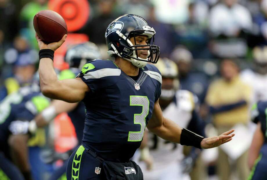 Seattle Seahawks quarterback Russell Wilson passes in the first half of an NFL football game against the St. Louis Rams on Sunday in Seattle. Photo: AP Photo/Elaine Thompson