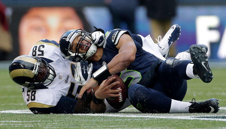 St. Louis Rams' Jo-Lonn Dunbar (58) sacks Seattle Seahawks quarterback Russell Wilson in the first half of an NFL football game on Sunday in Seattle. Photo: AP Photo/Elaine Thompson
