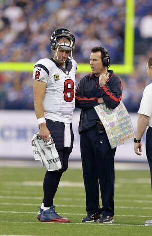 Houston Texans head coach Gary Kubiak talks to quarterback Matt Schaub during the first half of an NFL football game against the Indianapolis Colts Sunday, Dec. 30, 2012, in Indianapolis. (AP Photo/Michael Conroy) Photo: Michael Conroy, Associated Press / AP
