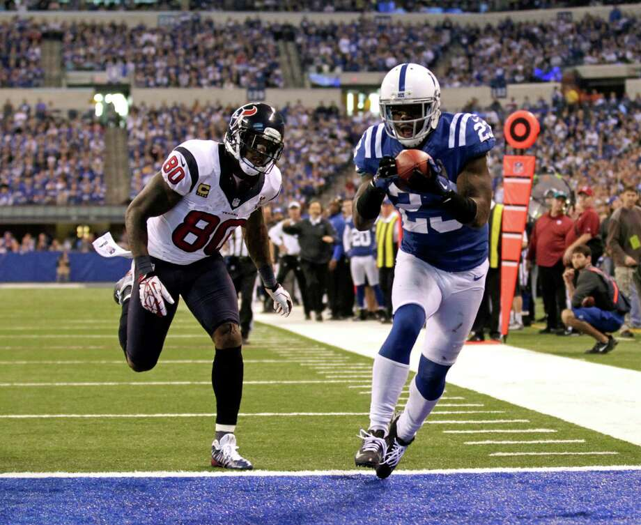 Indianapolis Colts' Vontae Davis (23) makes in interception against Houston Texans' Andre Johnson (80) during the second half of an NFL football game, Sunday, Dec. 30, 2012, in Indianapolis. (AP Photo/AJ Mast) Photo: AJ Mast, Associated Press / FR123854 AP
