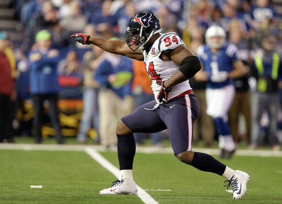 Houston Texans' Antonio Smith (94) reacts during the first half of an NFL football game against the Indianapolis Colts Sunday, Dec. 30, 2012, in Indianapolis. (AP Photo/Michael Conroy) Photo: Michael Conroy, Associated Press / AP