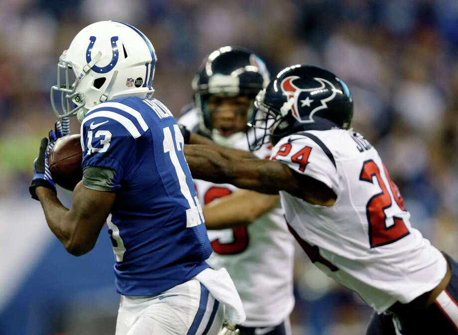 Indianapolis Colts' T.Y. Hilton (13) makes a 70-yard touchdown reception against Houston Texans' Johnathan Joseph (24) during the second half of an NFL football game, Sunday, Dec. 30, 2012, in Indianapolis. (AP Photo/Michael Conroy) Photo: Michael Conroy, Associated Press / AP