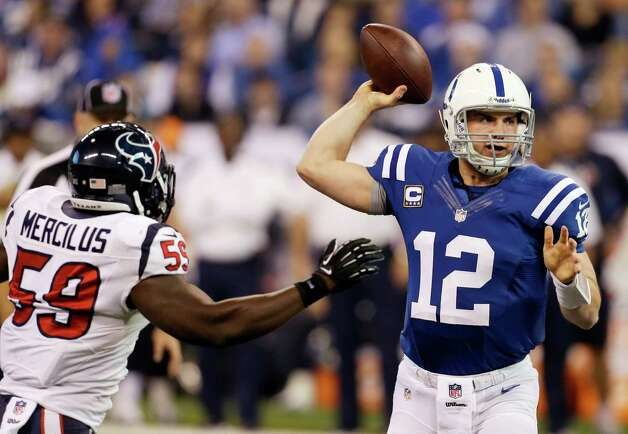 Indianapolis Colts' Andrew Luck (12) throws while pressured by Houston Texans' Whitney Mercilus (59) during the first half of an NFL football game on Sunday, Dec. 30, 2012, in Indianapolis. (AP Photo/Darron Cummings) Photo: Darron Cummings, Associated Press / AP