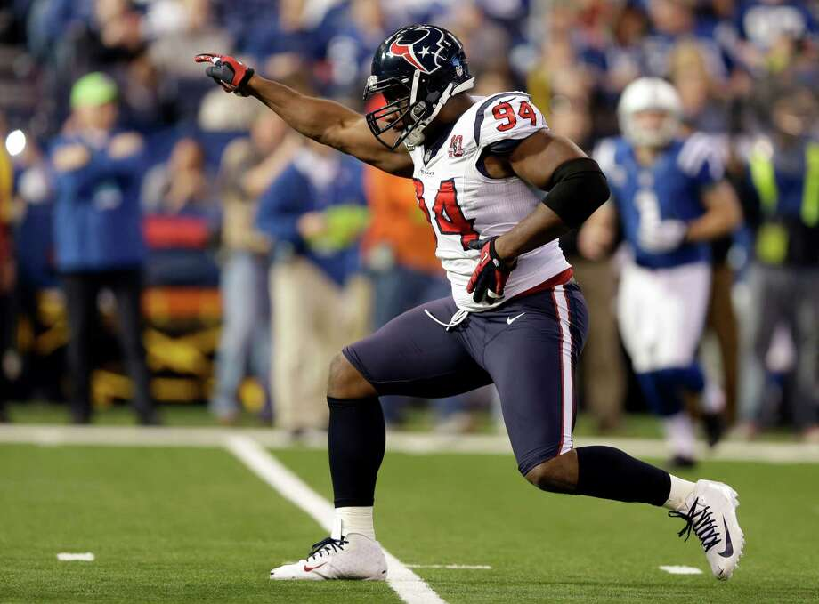 Houston Texans' Antonio Smith (94) reacts following a play during the first half of an NFL football game against the Indianapolis Colts, Sunday, Dec. 30, 2012, in Indianapolis. (AP Photo/Michael Conroy) Photo: Michael Conroy, Associated Press / AP