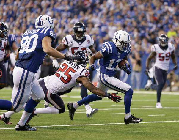 Indianapolis Colts' T.Y. Hilton (13) is tackled by Houston Texans' Kareem Jackson (25) during the first half of an NFL football game Sunday, Dec. 30, 2012, in Indianapolis. (AP Photo/Michael Conroy) Photo: Michael Conroy, Associated Press / AP