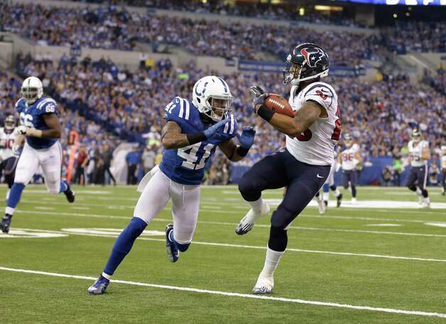 Houston Texans' Arian Foster (23) runs against Indianapolis Colts' Antoine Bethea during the second half of an NFL football game Sunday, Dec. 30, 2012, in Indianapolis. (AP Photo/Michael Conroy) Photo: Michael Conroy, Associated Press / AP