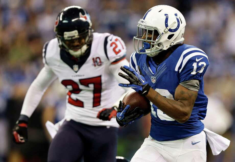 Indianapolis Colts' T.Y. Hilton (13) makes a 70-yard touchdown reception against Houston Texans' Quintin Demps (27) during the second half of an NFL football game, Sunday, Dec. 30, 2012, in Indianapolis. (AP Photo/Michael Conroy) Photo: Michael Conroy, Associated Press / AP