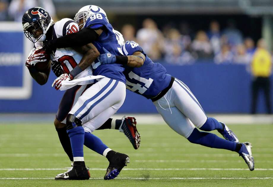 Houston Texans' Andre Johnson (80) is tackled by Indianapolis Colts' Robert Mathis (98) and Antoine Bethea (41) during the first half of an NFL football game on Sunday, Dec. 30, 2012, in Indianapolis. (AP Photo/Michael Conroy) Photo: Michael Conroy, Associated Press / AP