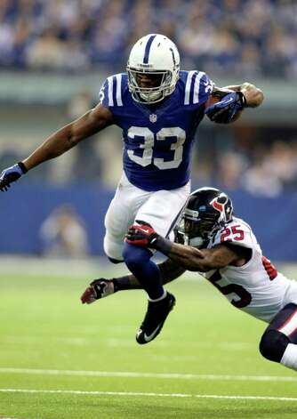 Houston Texans' Kareem Jackson (25) tackles Indianapolis Colts' Vick Ballard (33) during the first half of an NFL football game, Sunday, Dec. 30, 2012, in Indianapolis. (AP Photo/AJ Mast) Photo: AJ Mast, Associated Press / FR123854 AP