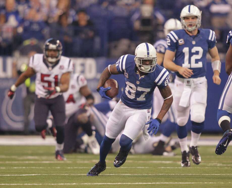 Indianapolis Colts' Reggie Wayne (87) runs during the first half of an NFL football game against the Houston Texans Sunday, Dec. 30, 2012, in Indianapolis. (AP Photo/AJ Mast) Photo: AJ Mast, Associated Press / FR123854 AP
