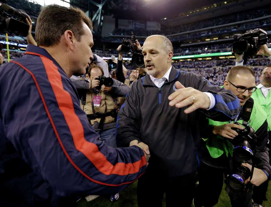 Indianapolis Colts head coach Chuck Pagano, right, is congratulated by Houston Texans head coach Gary Kubiak following an NFL football game, Sunday, Dec. 30, 2012, in Indianapolis. The Colts won 28-16. (AP Photo/Michael Conroy) Photo: Michael Conroy, Associated Press / AP