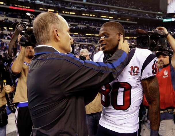 Indianapolis Colts head coach Chuck Pagano, left, talks to Houston Texans' Andre Johnson following an NFL football game, Sunday, Dec. 30, 2012, in Indianapolis. The Colts won the game 28-16. (AP Photo/Michael Conroy) Photo: Michael Conroy, Associated Press / AP