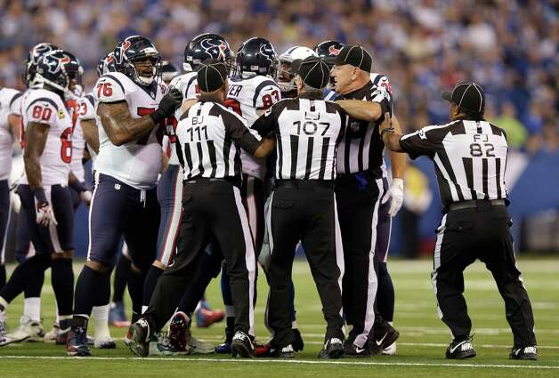 Officials separate Indianapolis Colts and Houston Texans players  during the second half of an NFL football game Sunday, Dec. 30, 2012, in Indianapolis. (AP Photo/Michael Conroy) Photo: Michael Conroy, Associated Press / AP