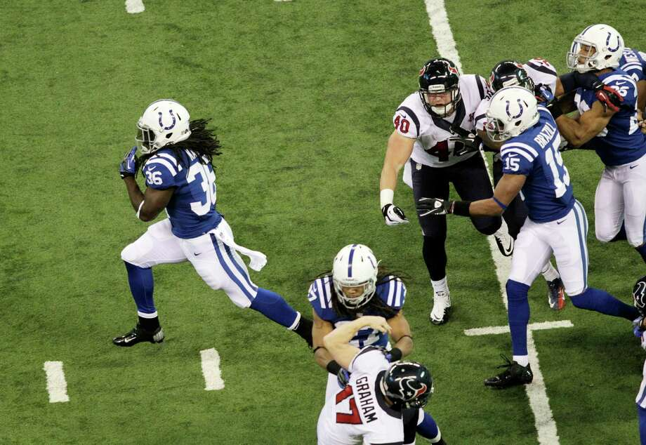 Indianapolis Colts' Deji Karim, left, runs back a kickoff 101-yards for a touchdown during the second half of an NFL football game against the Houston Texans Sunday, Dec. 30, 2012, in Indianapolis. (AP Photo/AJ Mast) Photo: AJ Mast, Associated Press / FR123854 AP