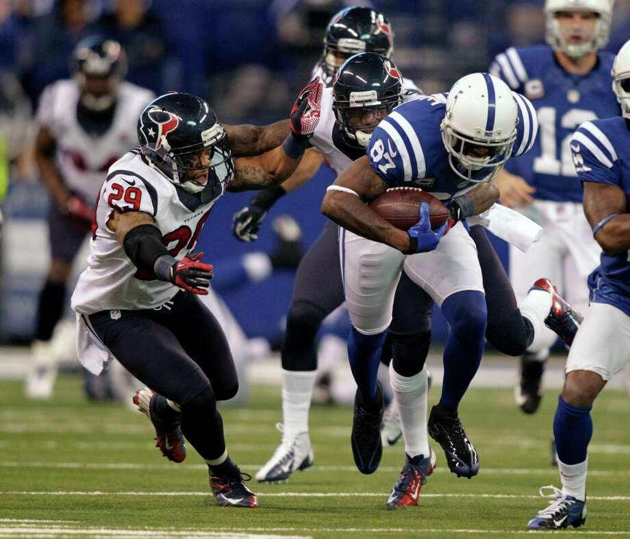 Indianapolis Colts' Reggie Wayne (87) is tackled by Houston Texans' Glover Quin (29) during the first half of an NFL football game on Sunday, Dec. 30, 2012, in Indianapolis. (AP Photo/AJ Mast) Photo: AJ Mast, Associated Press / FR123854 AP