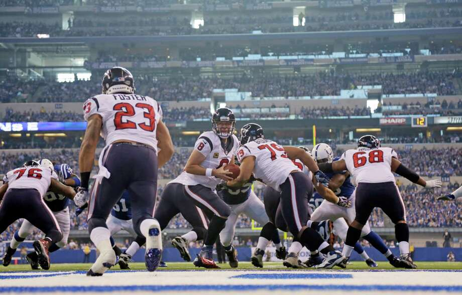 Houston Texans' Matt Schaub (8) hands off to Arian Foster (23) during the first half of an NFL football game against the Indianapolis Colts Sunday, Dec. 30, 2012, in Indianapolis. (AP Photo/AJ Mast) Photo: AJ Mast, Associated Press / FR123854 AP