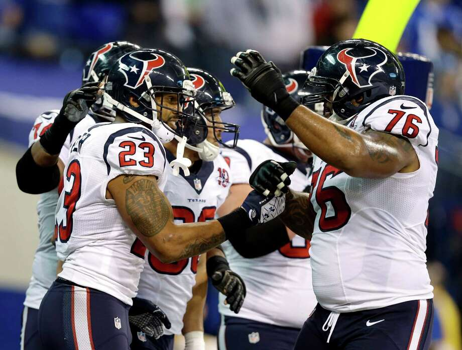 Houston Texans' Arian Foster (23) celebrates with his teammates following a 13-yard touchdown run during the second half of an NFL football game against the Indianapolis Colts, Sunday, Dec. 30, 2012, in Indianapolis. (AP Photo/Michael Conroy) Photo: Michael Conroy, Associated Press / AP