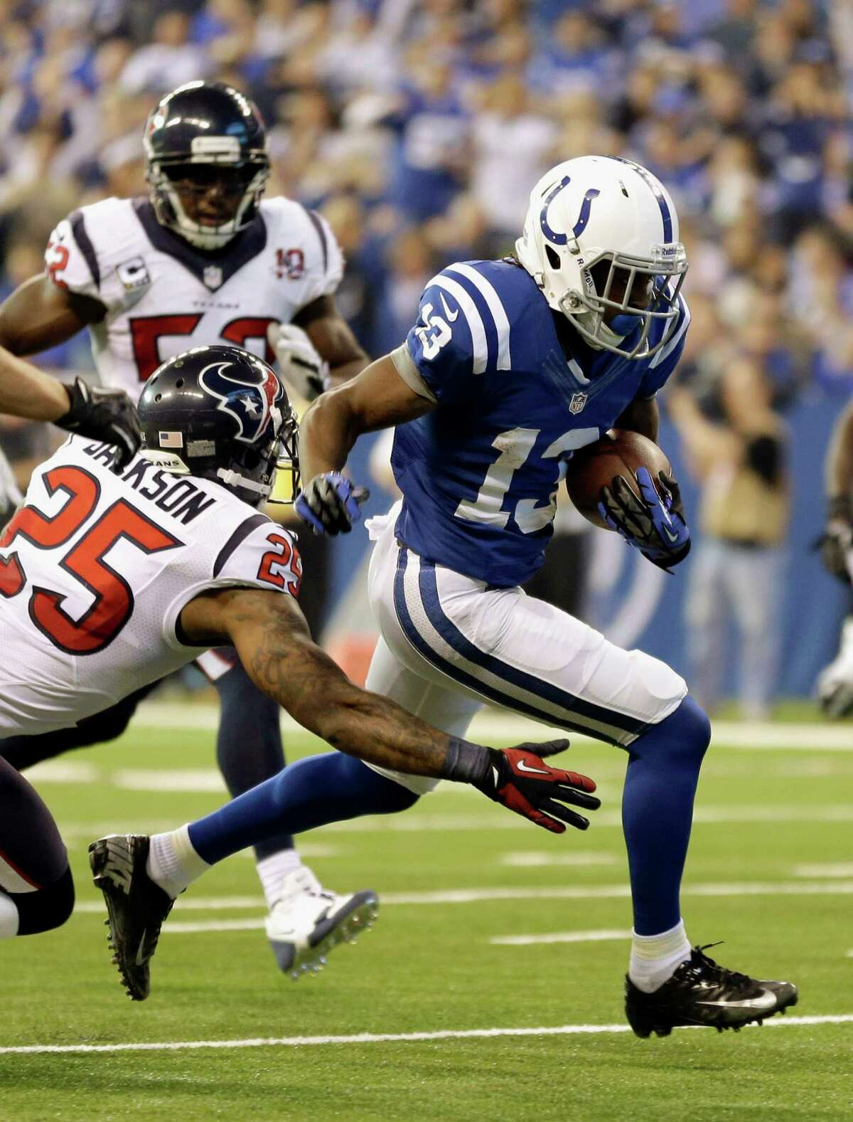 Houston Texans' Kareem Jackson (25) tackles Indianapolis Colts' T.Y. Hilton (13) during the first half of an NFL football game, Sunday, Dec. 30, 2012, in Indianapolis. (AP Photo/Michael Conroy)