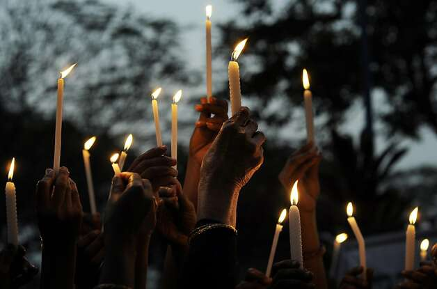 Indian activists take part in a candlelight vigil in Kolkata on December 30, 2012, after the cremation ceremony for a gangrape victim. The victim of a gang-rape and murder which triggered an outpouring of grief and anger across India was cremated at a private ceremony, hours after her body was flown home from Singapore. A student of 23-year-old, the focus of nationwide protests since she was brutally attacked on a bus in New Delhi two weeks ago, was cremated away from the public glare at the request of her traumatised parents.  AFP PHOTO/Dibyangshu SARKARDIBYANGSHU SARKAR/AFP/Getty Images Photo: Dibyangshu Sarkar, AFP/Getty Images